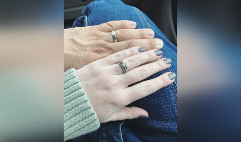 Husband and wife's hands, color photo