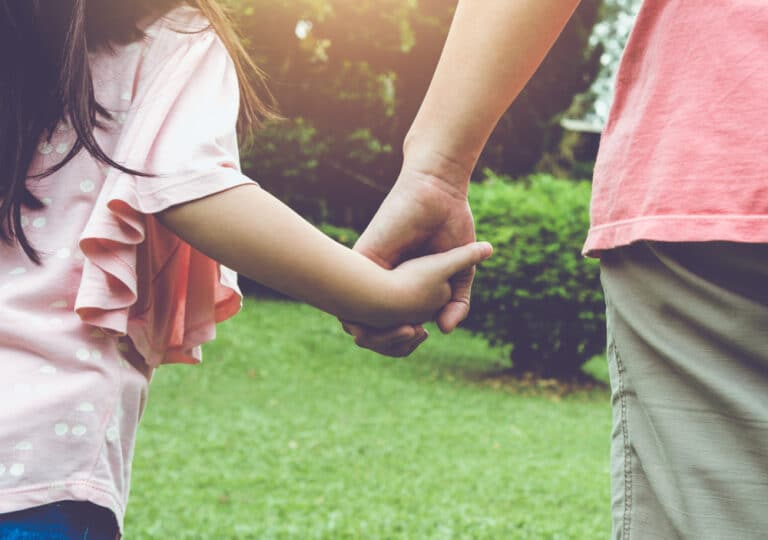 Holding young girl's hand
