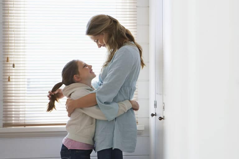 Mother arm around child
