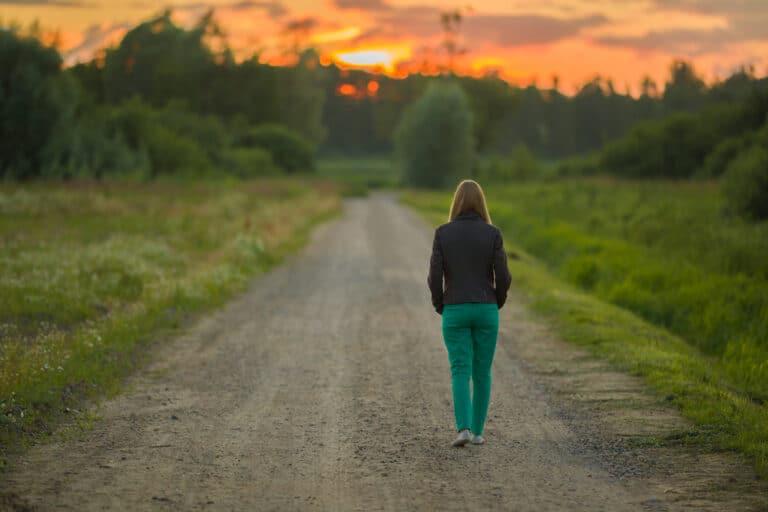 Woman walking on road alone
