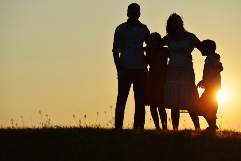 Family silhouette at sunset