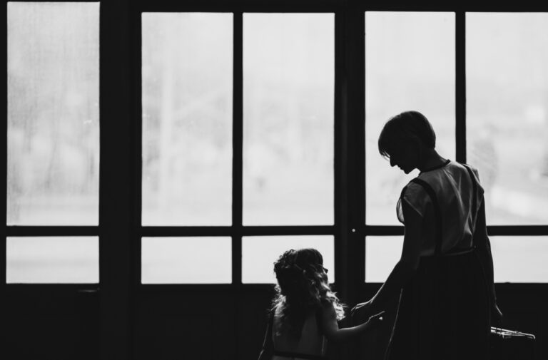 Mother looking at child silhouette