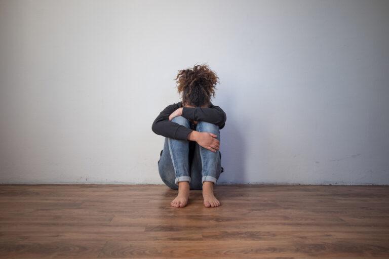 Woman hugging knees