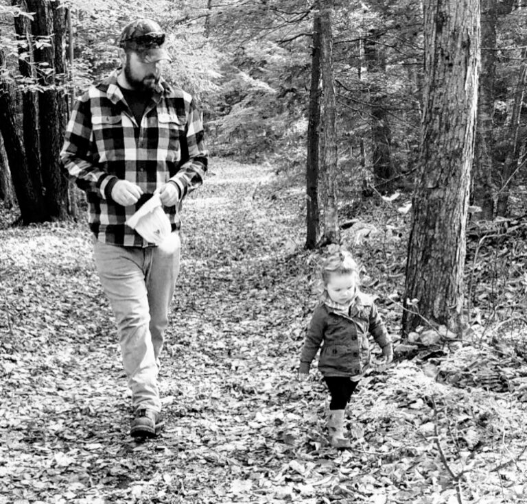 Man walking with toddler