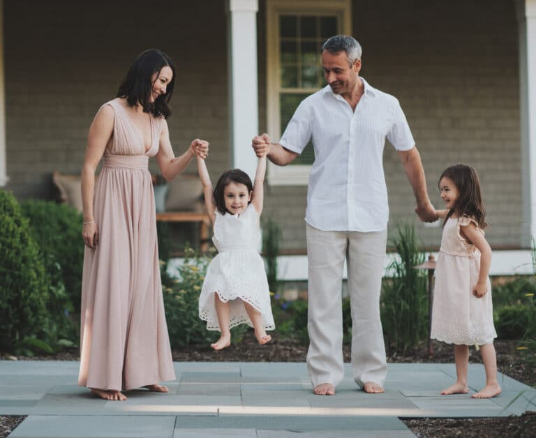 Husband and wife with two children, color photo