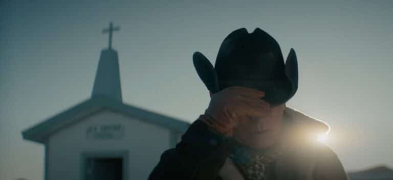 Cowboy in front of church