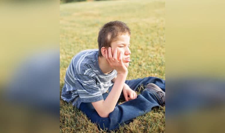 Boy sitting in grass