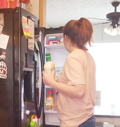 Mom getting food from fridge