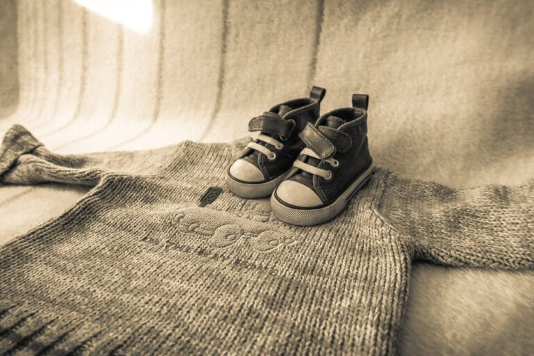 Baby shoes and sweater