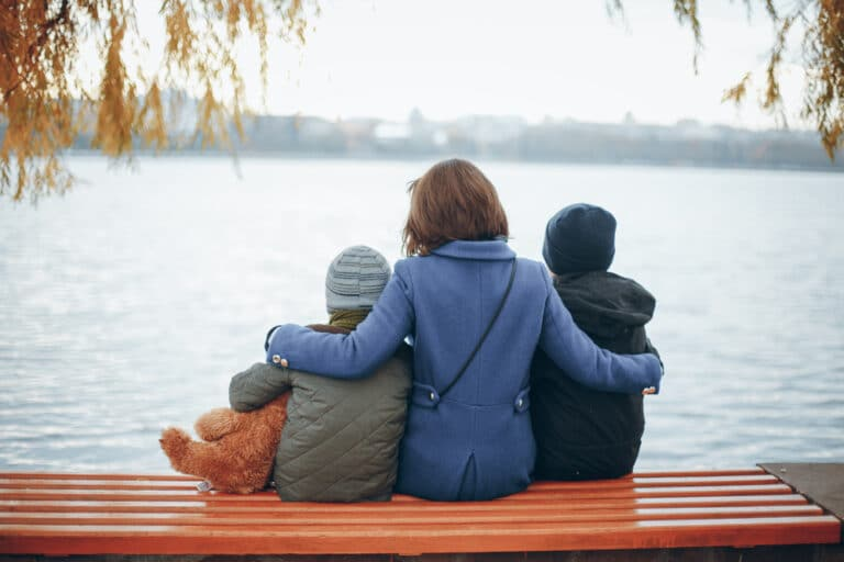 Mom with two kids on bench
