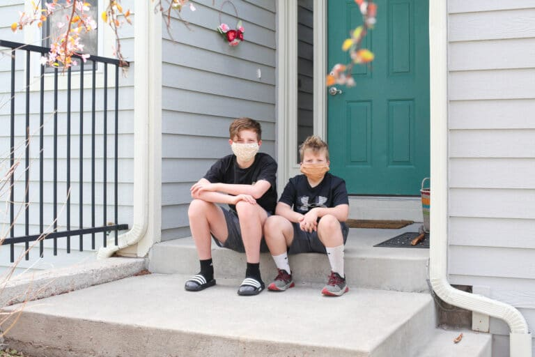 Young boys sitting on front step
