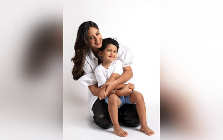 Mother holding son, color photo
