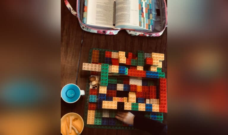 Bible next to LEGOs, color photo
