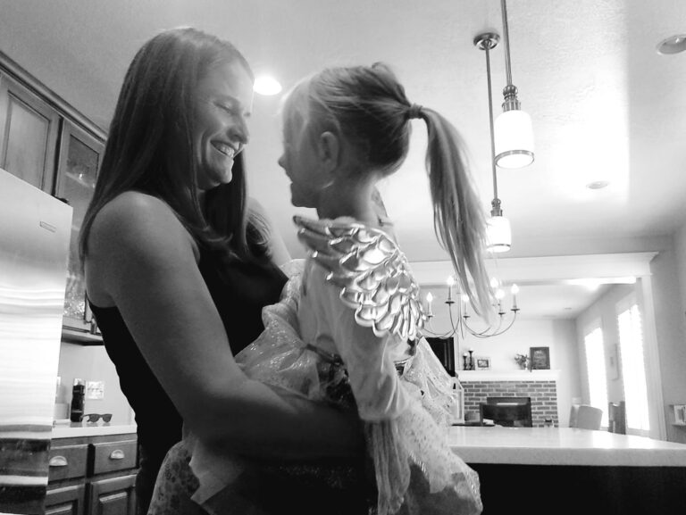 mother and daughter black and white photo