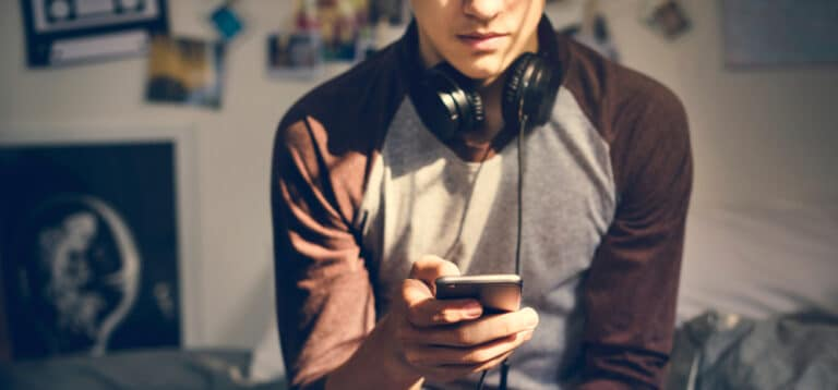 Teen boy using phone