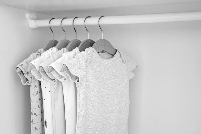 Baby onesies hanging in closet