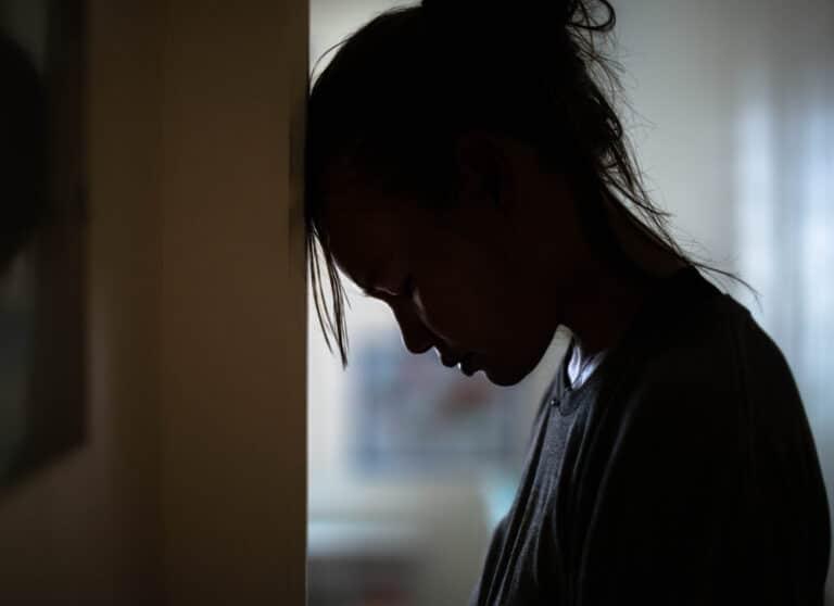 Sad woman head on wall