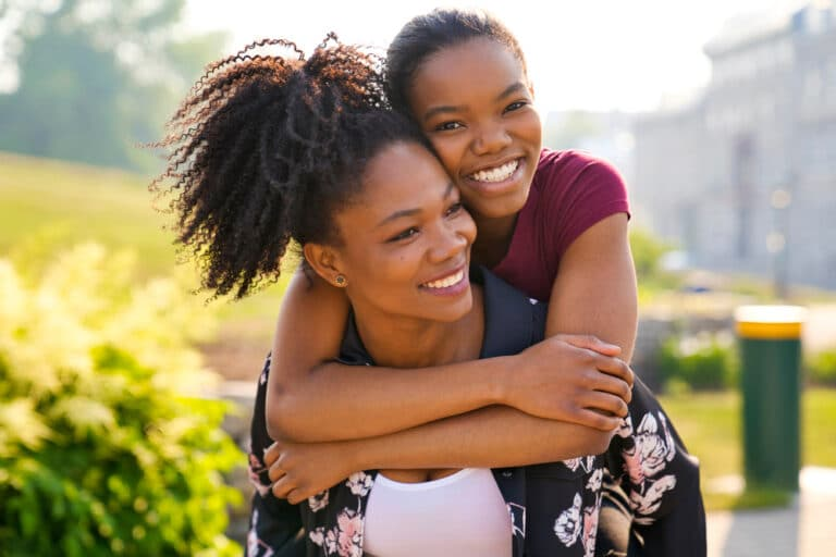 Mom with teen smiling