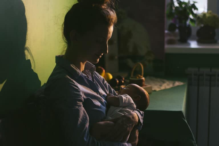Mother holding baby at night