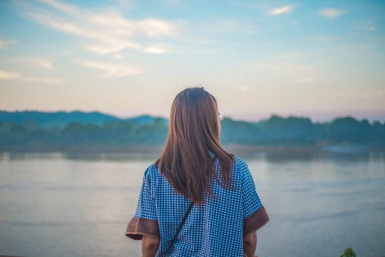 Woman looking out at water