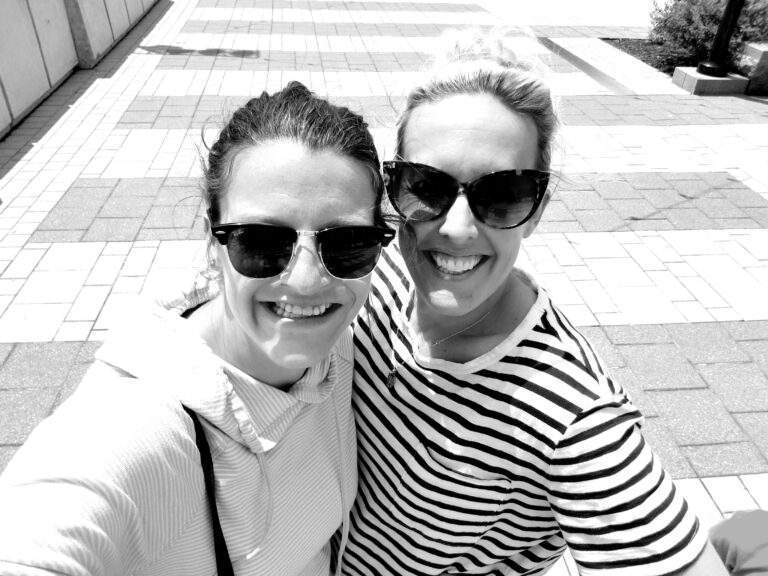 Selfie of two women smiling, black-and-white photo