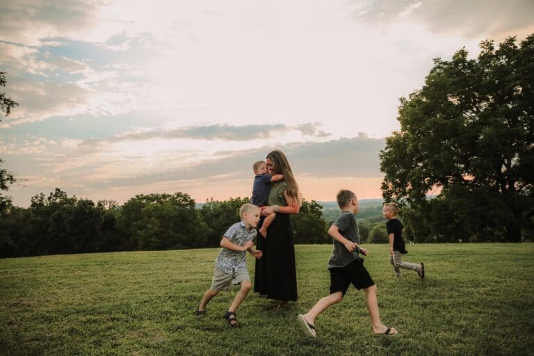 Mother surrounded by four sons, color photo