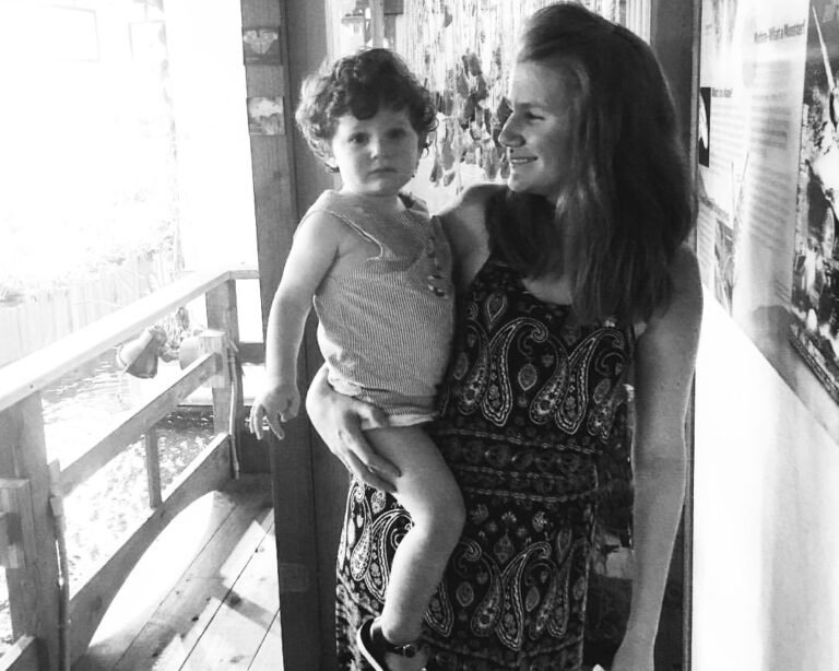 Mother holding son, black-and-white photo