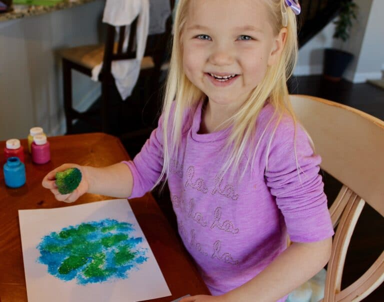 Little girl doing stamp activity, color photo