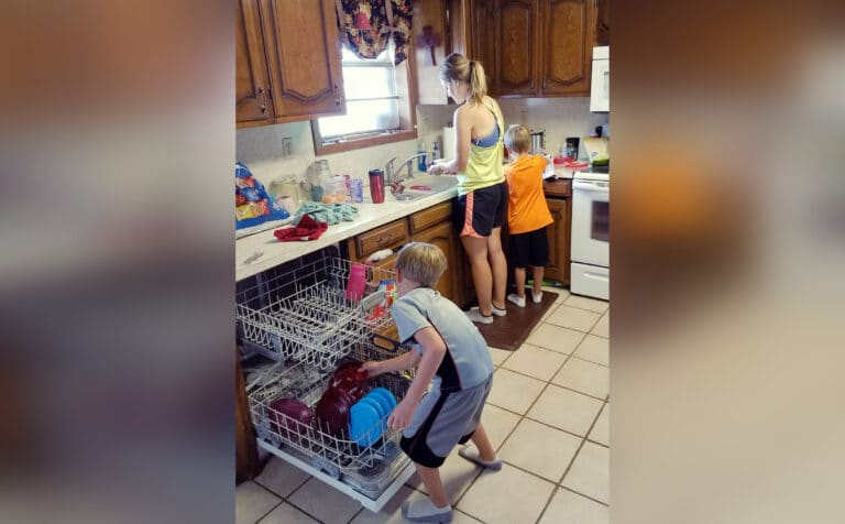 mother in kitchen doing chores with kids