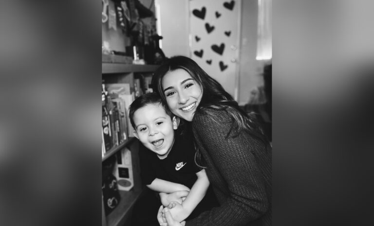 Mother and son smiling, black-and-white photo