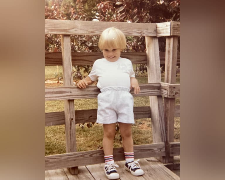 Picture of little boy standing on deck, color photo