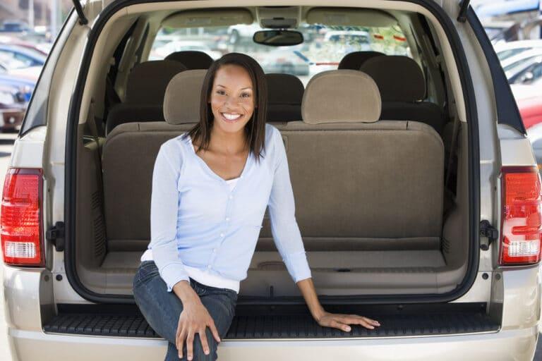 Woman in back of minivan
