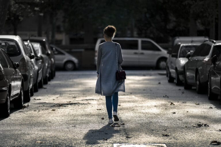 Woman walking down road