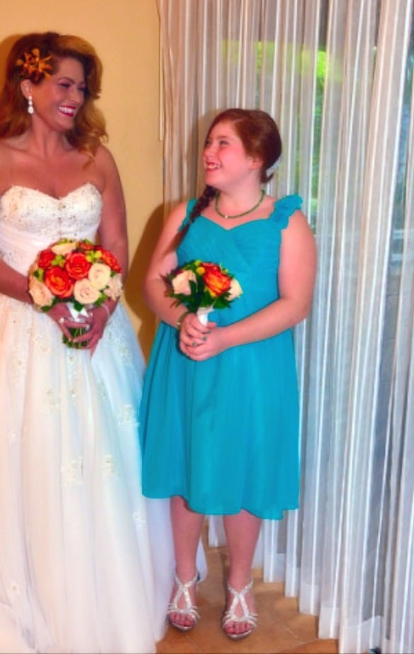 woman in wedding dress with teen girl