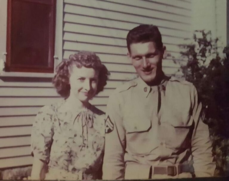 Old photo of man and woman standing together, black-and-white photo