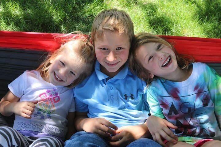 Three smiling children, color photo