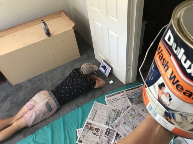 Boy lying on floor with iPad, color photo
