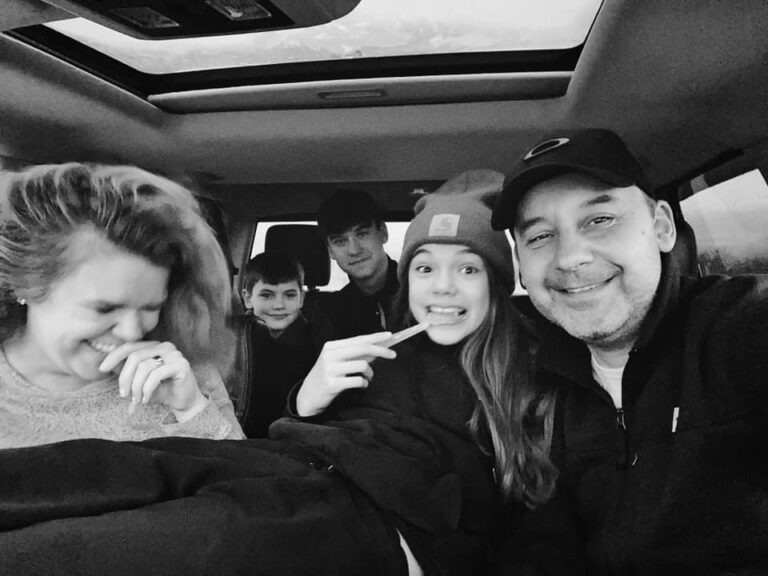 Teens with parents in car