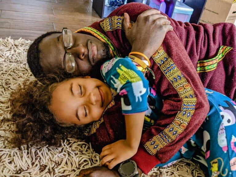 Father and child hug