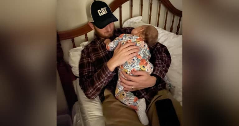 Dad holding baby, color photo