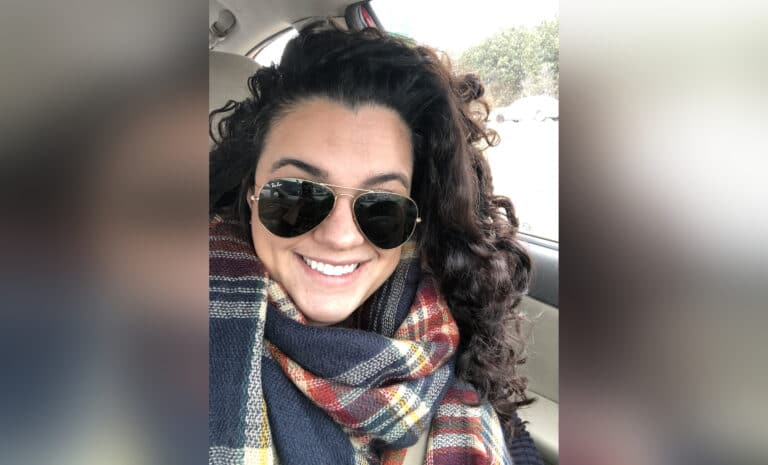 Woman smiling in selfie, color photo