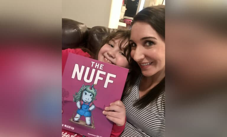 "Mother and daughter holding book title ""The Nuff,"" color photo"