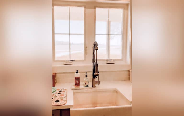 Clean kitchen sink, color photo