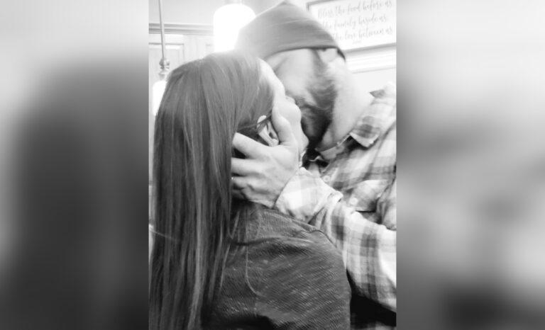 Man kissing woman black and white photo