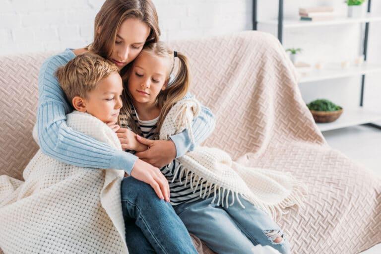 Mother hugging kids