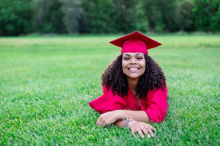 High school graduate smiling outside