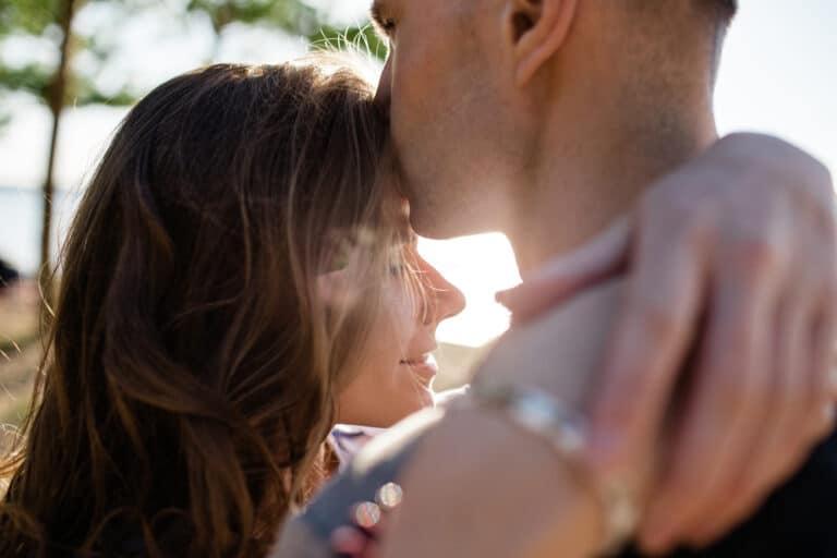 Smiling couple kiss