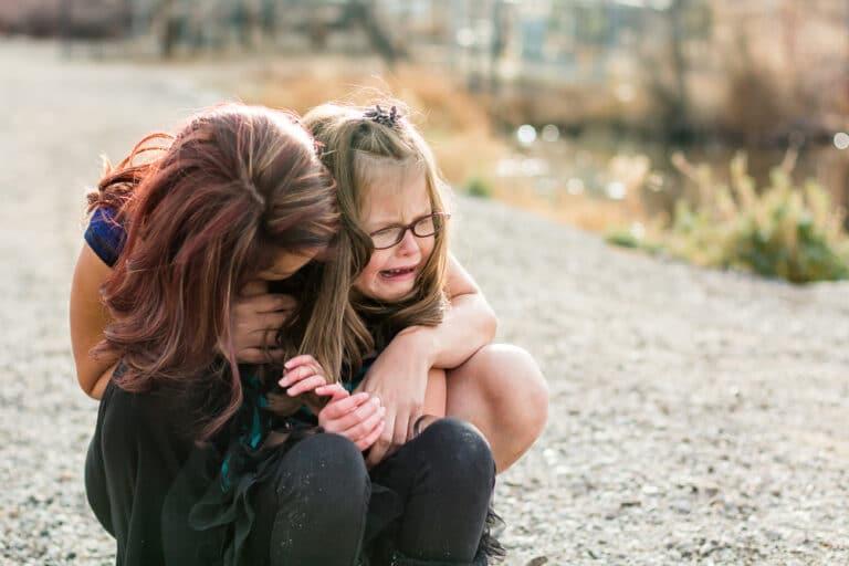 Mom hugging crying child