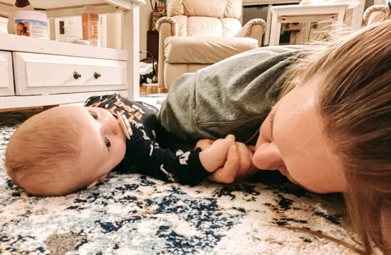 Mother and infant lying on floor, color photo