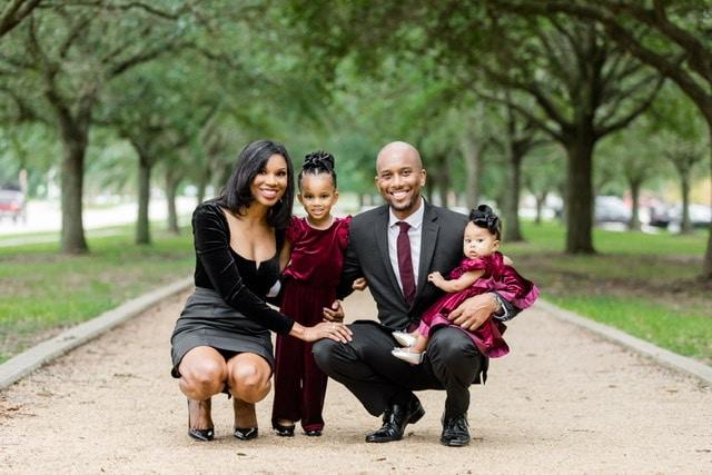 Black family posing outside